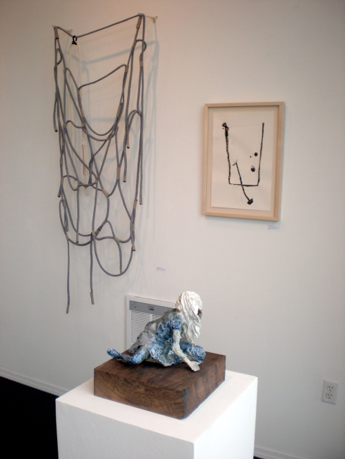 Work by Cynthia Lahti (foreground) and Blair Saxon-Hill (background)